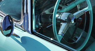 close up of outside of drivers side of a classic car